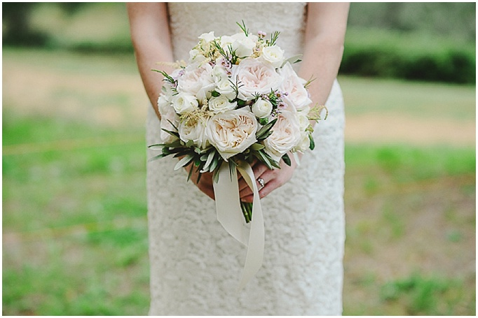 Rustic wedding in Tuscany - Featured on My Lovely Wedding Blog. Close up shot of bride holding bouquet.