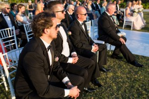 The groomsmen wearing black suits and shades